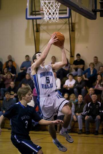 Hoosick Falls' #5 Andrew Hoag goes in for a layup during the boys' basketball game against Lake Geor