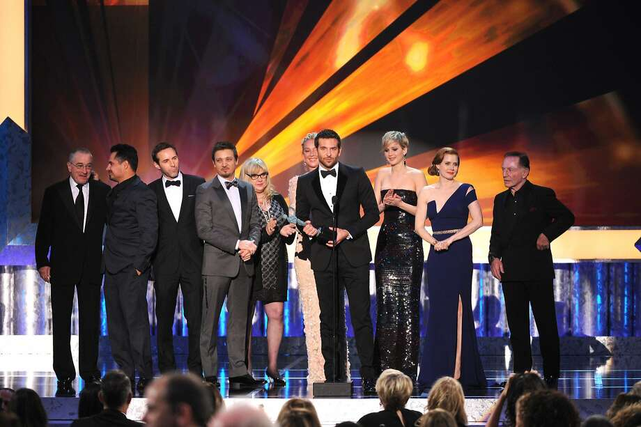 "The actors in ""American Hustle"" accept the award for outstanding cast at the Screen Actors Guild Awards. The honor set up the comedy as the film to beat at the Academy Awards. Photo: Frank Micelotta, Associated Press"