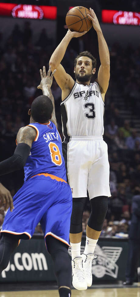 Shooting guard Marco Belinelli leads the league with a 49.6 percent shooting clip from 3-point range in his first season with the Spurs. Photo: Tom Reel / San Antonio Express-News
