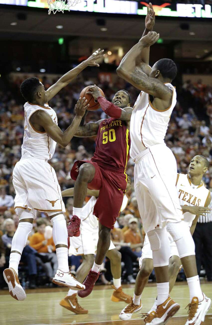 Iowa State's DeAndre Kane (50) drives to the basket between Texas defenders Isaiah Taylor, left, and Prince Ibeh, right, during the second half on an NCAA college basketball game, Saturday, Jan. 18, 2014, in Austin, Texas. Texas won 86-76. (AP Photo/Eric Gay)