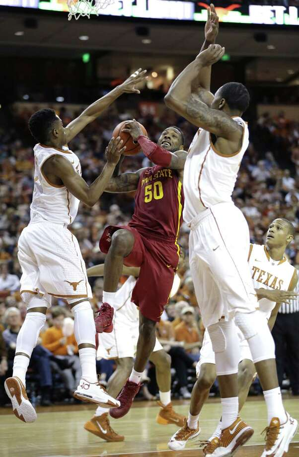 Iowa State's DeAndre Kane (50) drives to the basket between Texas defenders Isaiah Taylor, left, and Prince Ibeh, right, during the second half on an NCAA college basketball game, Saturday, Jan. 18, 2014, in Austin, Texas. Texas won 86-76. (AP Photo/Eric Gay) Photo: Eric Gay, Associated Press / AP