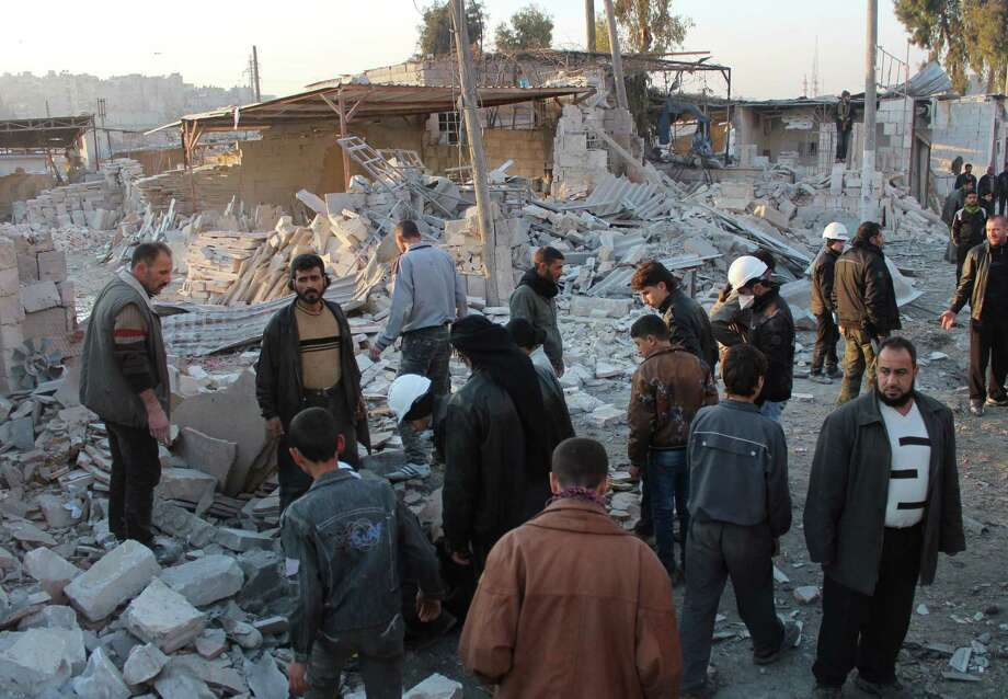 Syrians search for survivors after a building collapsed allegedly following airstrikes in the city of Aleppo. International peace talks are aiming to end Syria's nearly three-year civil war. Photo: Salah Al-Ashkar / Getty Images / AFP