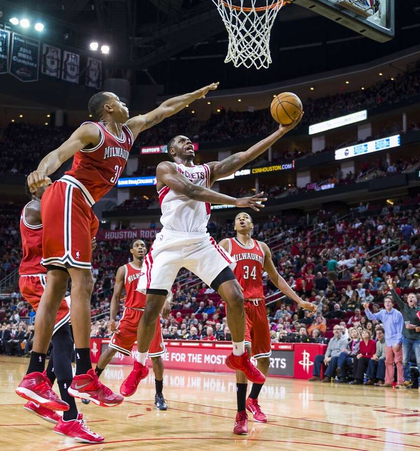 Rockets forward Terrence Jones slices through the Bucks defense for two of his career-high 36 points. Photo: Smiley N. Pool, Houston Chronicle