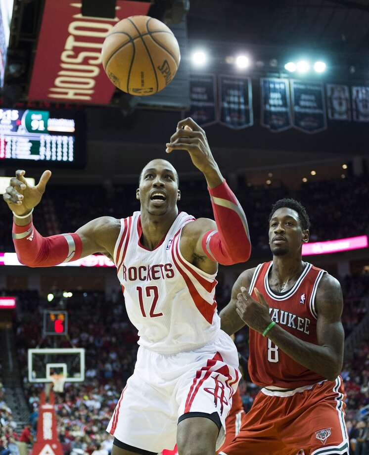 Rockets center Dwight Howard reaches for a rebound against Bucks center Larry Sanders. Photo: Smiley N. Pool, Houston Chronicle