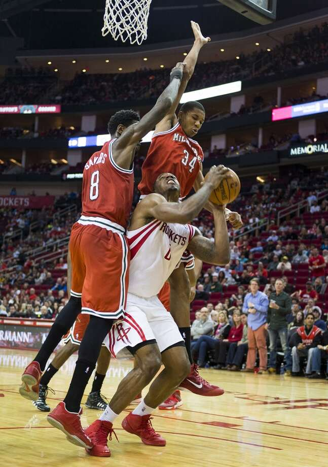 Rockets power forward Terrence Jones is defended by Bucks center Larry Sanders (8) and guard Giannis Antetokounmpo. Photo: Smiley N. Pool, Houston Chronicle