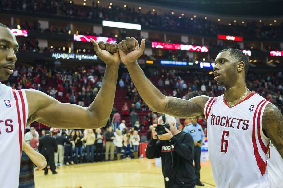 Rockets forward Terrence Jones (6) is congratulated by center Dwight Howard after a victory over the Bucks. Photo: Smiley N. Pool, Houston Chronicle
