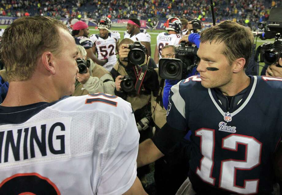Broncos QB Peyton Manning (left) and Patriots rival Tom Brady could be in their last matchup with a Super Bowl berth at stake. Photo: Steven Senne / Associated Press / AP