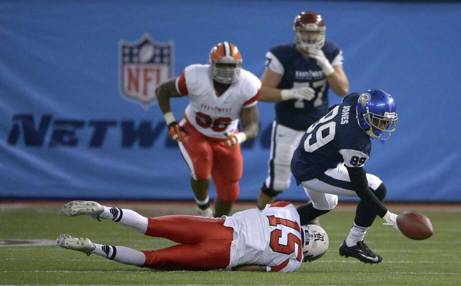 Rice's Phillip Gaines of the East (on ground), a Judson grad, breaks up a pass for the West's Chandler Jones (89) in the East-West Shrine Game. Photo: Phelan M. Ebenhack / Associated Press / FR121174 AP