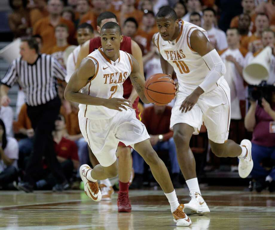 Texas' Demarcus Holland (2) moves the ball up court against Iowa State during the first half on an NCAA college basketball game, Saturday,  Jan. 18, 2014, in Austin, Texas. (AP Photo/Eric Gay) Photo: Eric Gay, Associated Press / AP