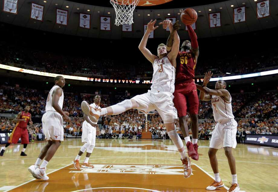 Texas' Connor Lammert (21) and Iowa State's DeAndre Kane (50) battle for a rebound during the second half on an NCAA college basketball game, Saturday,  Jan. 18, 2014, in Austin, Texas. Texas won 86-76. (AP Photo/Eric Gay) Photo: Eric Gay, Associated Press / AP