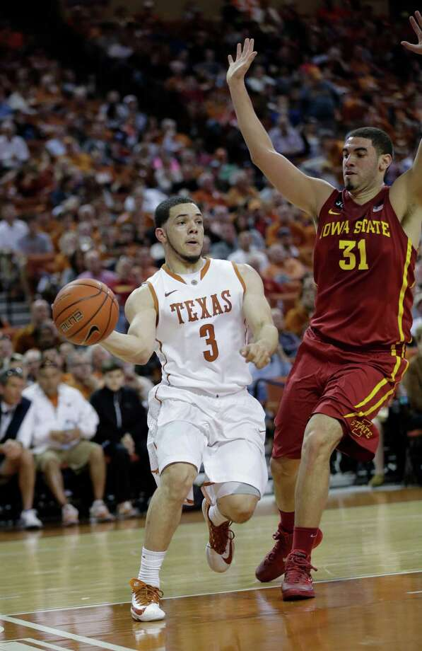 Texas' Javan Felix (3) passes around Iowa State's Georges Niang (31) during the first half on an NCAA college basketball game, Saturday,  Jan. 18, 2014, in Austin, Texas. (AP Photo/Eric Gay) Photo: Eric Gay, Associated Press / AP