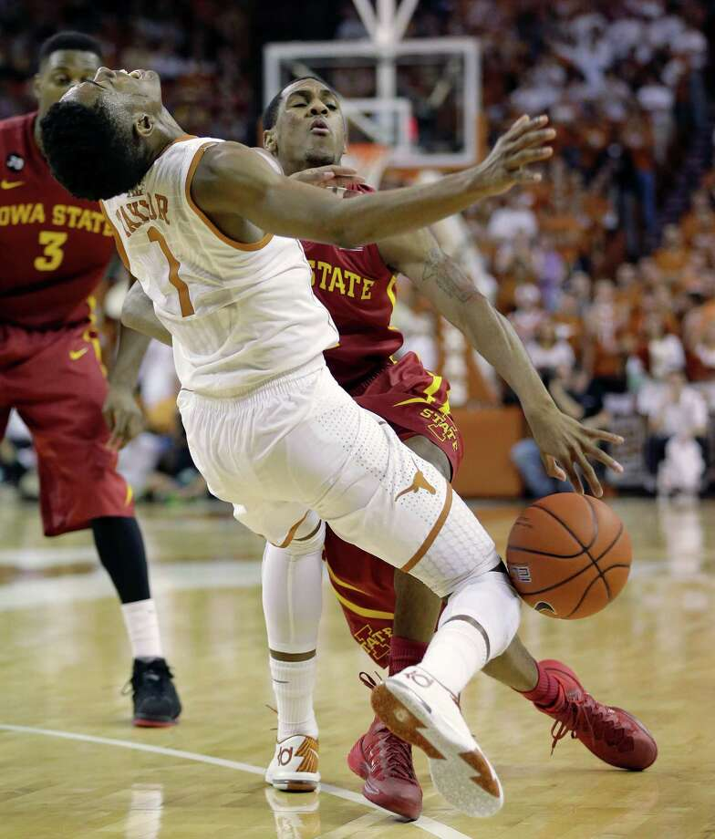 Iowa State's Monte Morris, right, crashes into Texas' Isaiah Taylor (1) during the second half on an NCAA college basketball game, Saturday,  Jan. 18, 2014, in Austin, Texas. (AP Photo/Eric Gay) Photo: Eric Gay, Associated Press / AP