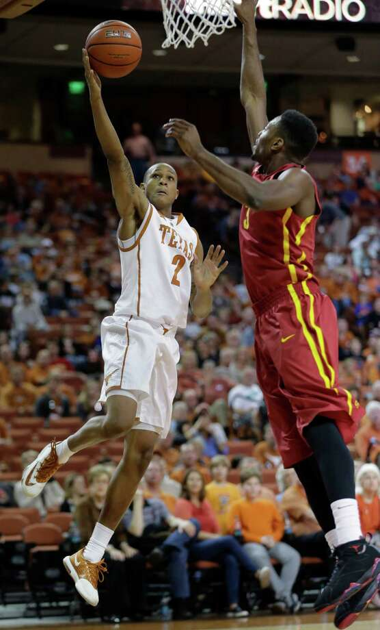 Texas' Demarcus Holland (2) shoots over Iowa State's Melvin Ejim, right, during the first half on an NCAA college basketball game, Saturday,  Jan. 18, 2014, in Austin, Texas. (AP Photo/Eric Gay) Photo: Eric Gay, Associated Press / AP