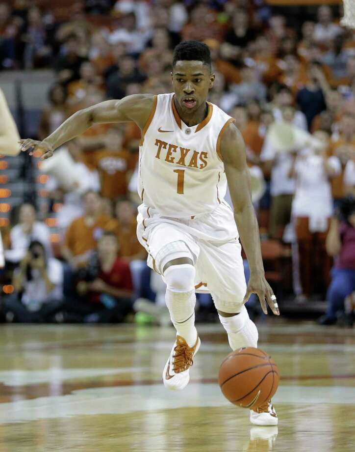 Texas' Isaiah Taylor (1) moves the ball up court against Iowa State during the first half on an NCAA college basketball game, Saturday,  Jan. 18, 2014, in Austin, Texas. (AP Photo/Eric Gay) Photo: Eric Gay, Associated Press / AP