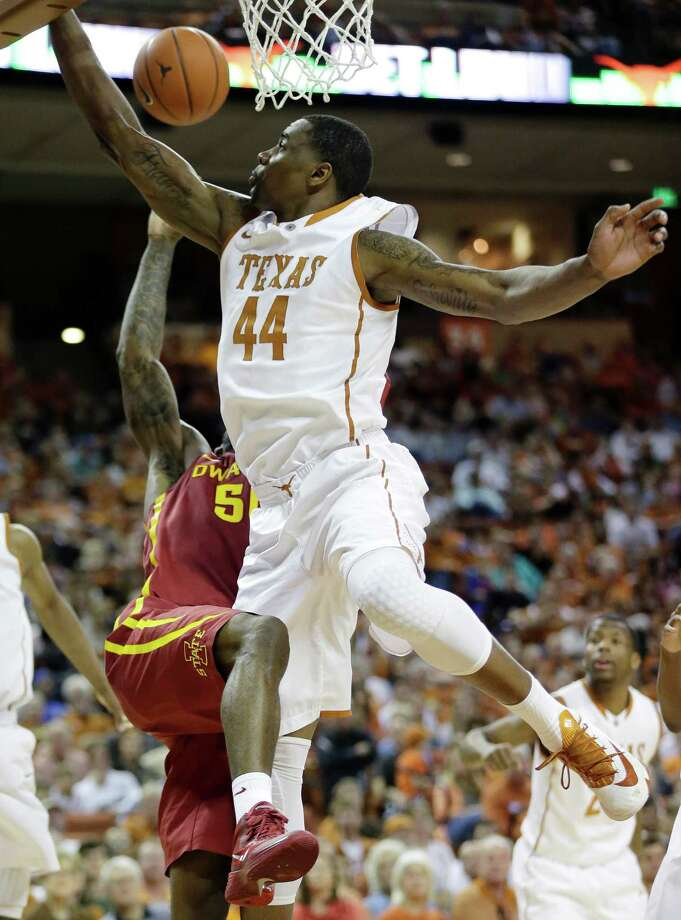 Iowa State's DeAndre Kane, left, is blocked by Texas' Prince Ibeh (44) as he tries to score during the second half on an NCAA college basketball game, Saturday, Jan. 18, 2014, in Austin, Texas. Texas won 86-76. (AP Photo/Eric Gay) Photo: Eric Gay, Associated Press / AP