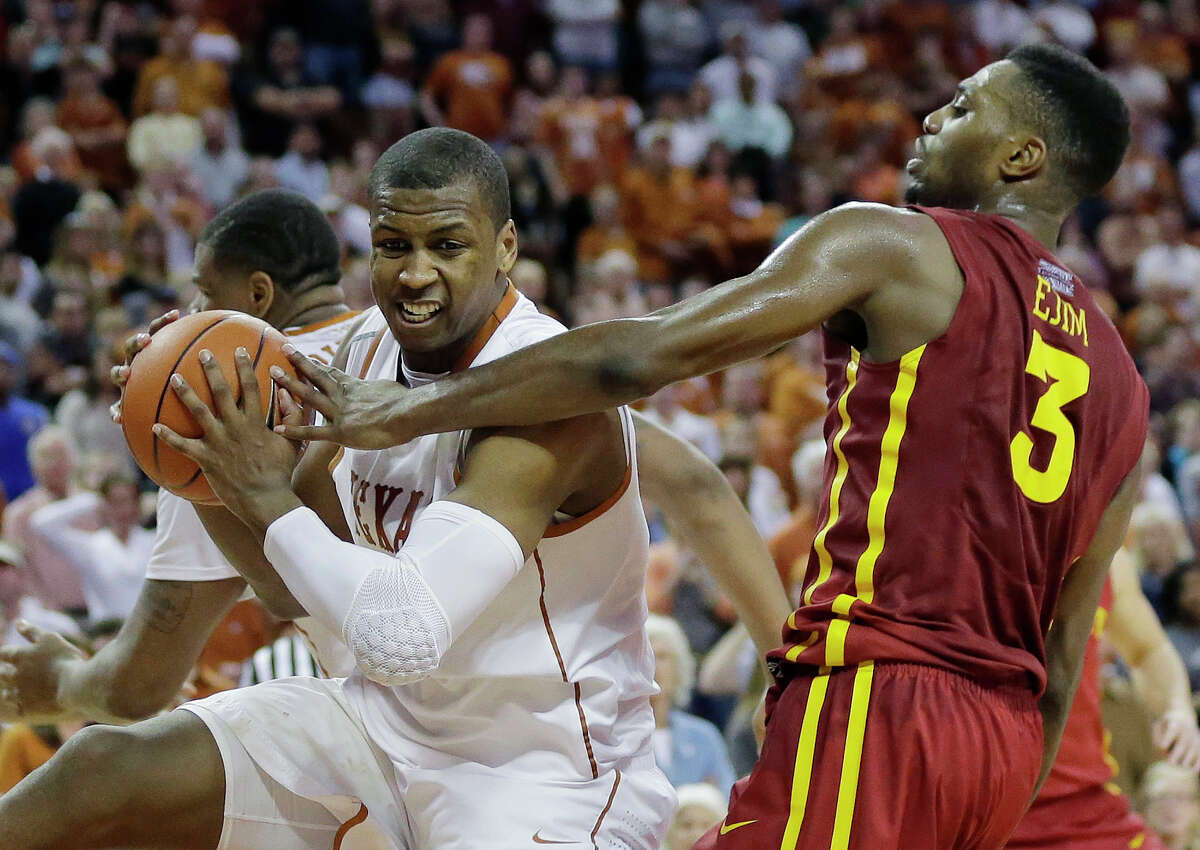 Texas' Jonathan Holmes, left, pulls down a rebound in front of Iowa State's Melvin Ejim (3) during the second half on an NCAA college basketball game, Saturday, Jan. 18, 2014, in Austin, Texas. Texas won 86-76. (AP Photo/Eric Gay)