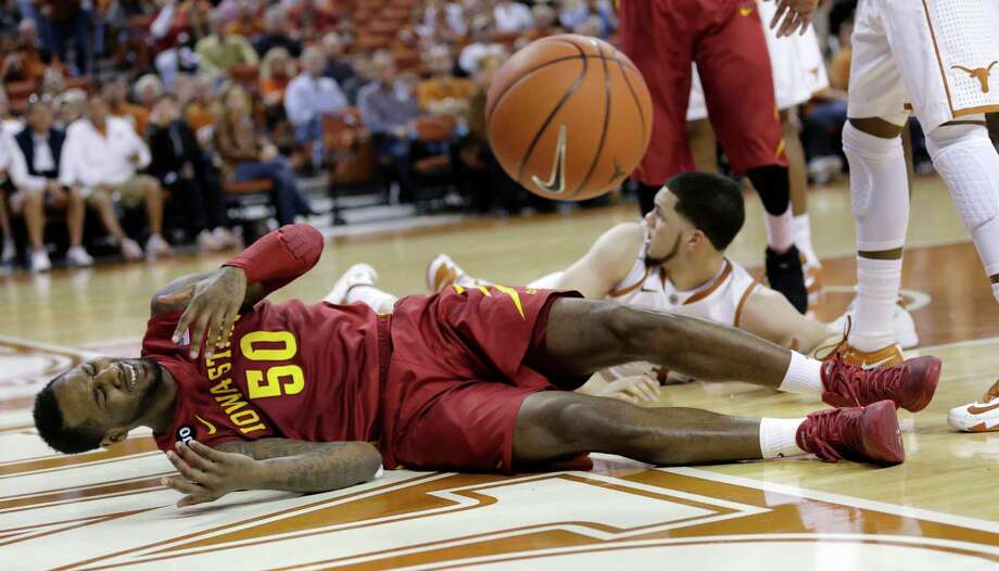 Iowa State's DeAndre Kane (50) and Texas' Javan Felix, back, fall on the floor chasing a loose ball during the second half on an NCAA college basketball game, Saturday, Jan. 18, 2014, in Austin, Texas. Texas won 86-76. (AP Photo/Eric Gay) Photo: Eric Gay, Associated Press / AP
