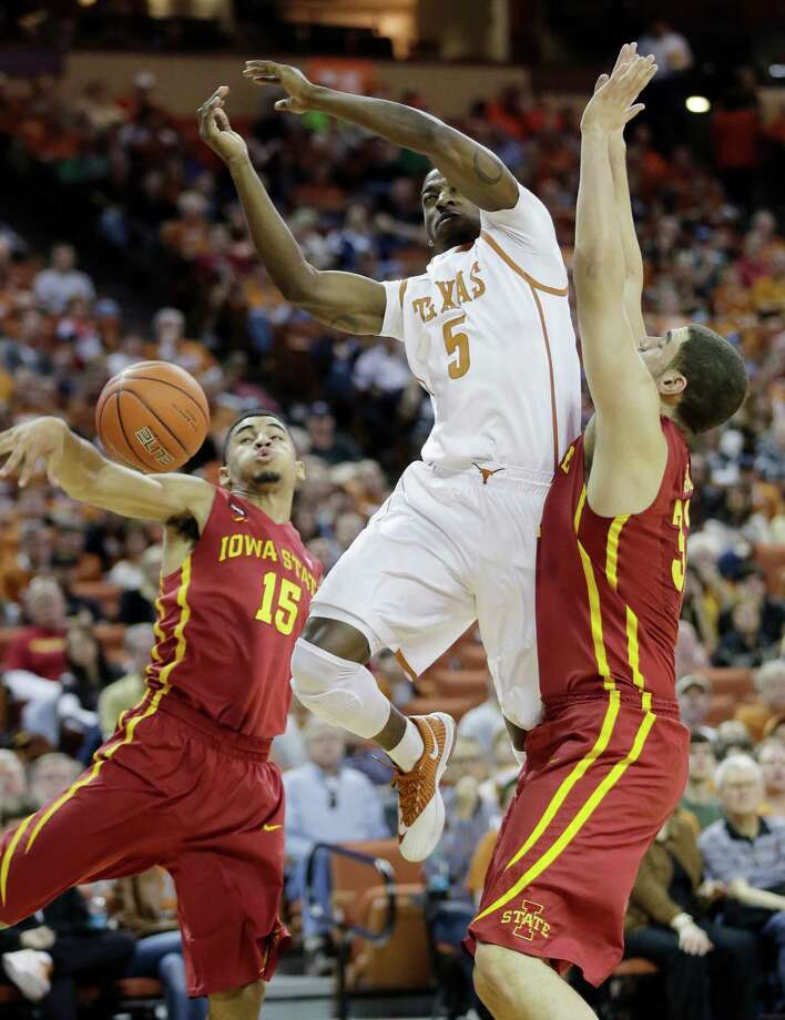 Texas' Damarcus Croaker (5) is stripped of the ball by Iowa State's Naz Long (15) and Georges Niang, right, during the first half on an NCAA college basketball game, Saturday,  Jan. 18, 2014, in Austin, Texas. (AP Photo/Eric Gay) Photo: Eric Gay, Associated Press / AP