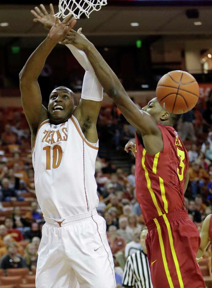 Texas' Jonathan Holmes (10) and Iowa State's Melvin Ejim (3) reach for a rebound during the first half on an NCAA college basketball game, Saturday,  Jan. 18, 2014, in Austin, Texas. (AP Photo/Eric Gay) Photo: Eric Gay, Associated Press / AP