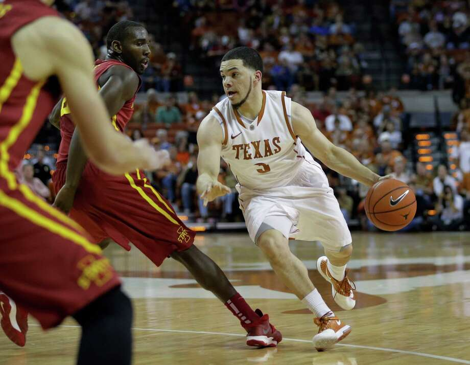 Texas' Javan Felix (3) moves the ball up court against Iowa State during the first half on an NCAA college basketball game, Saturday,  Jan. 18, 2014, in Austin, Texas. (AP Photo/Eric Gay) Photo: Eric Gay, Associated Press / AP