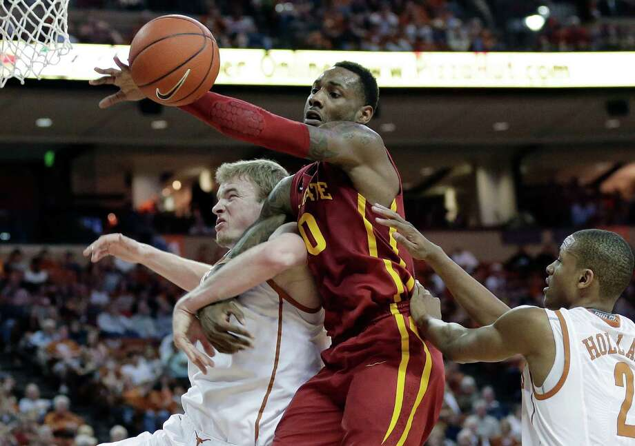 Iowa State's DeAndre Kane, center, battles Texas' Connor Lammert, left, and Demarcus Holland, right, for a rebound during the second half on an NCAA college basketball game, Saturday,  Jan. 18, 2014, in Austin, Texas. Texas won 86-76. (AP Photo/Eric Gay) Photo: Eric Gay, Associated Press / AP