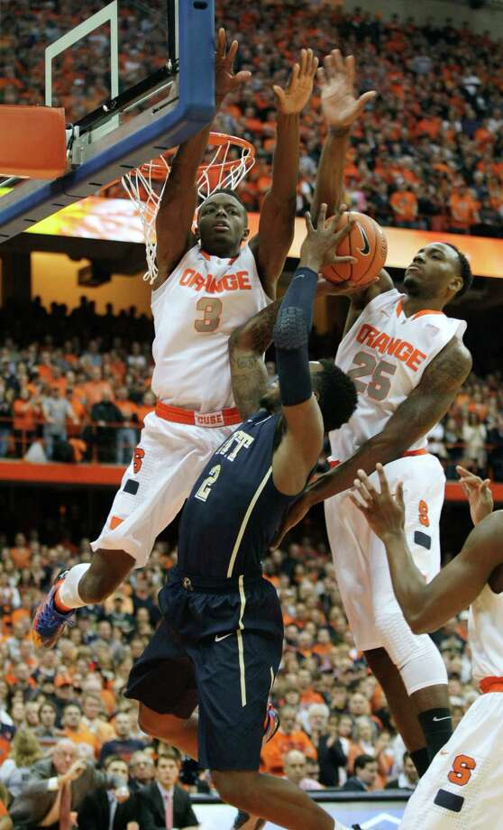 Syracuse's Jerami Grant (3) and Rakeem Christmas (26) put pressure on Pittsburgh's Michael Young in the first half of an NCAA college basketball game in Syracuse, N.Y., Saturday, Jan. 18, 2014. (AP Photo/Nick Lisi) ORG XMIT: NYNL101 Photo: Nick Lisi / FR171024 AP