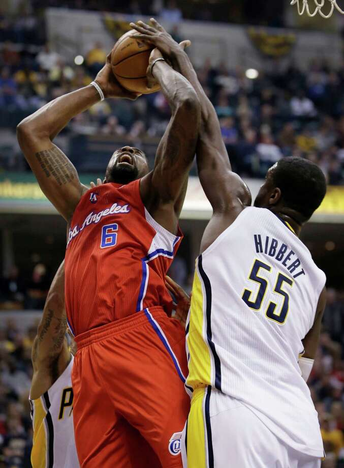 Los Angeles Clippers center DeAndre Jordan (6) gets his shot blocked by Indiana Pacers center Roy Hibbert (55) during the first half of an NBA basketball game in Indianapolis, Saturday, Jan. 18, 2014. (AP Photo/AJ Mast) ORG XMIT: INAM104 Photo: AJ MAST / FR123854 AP
