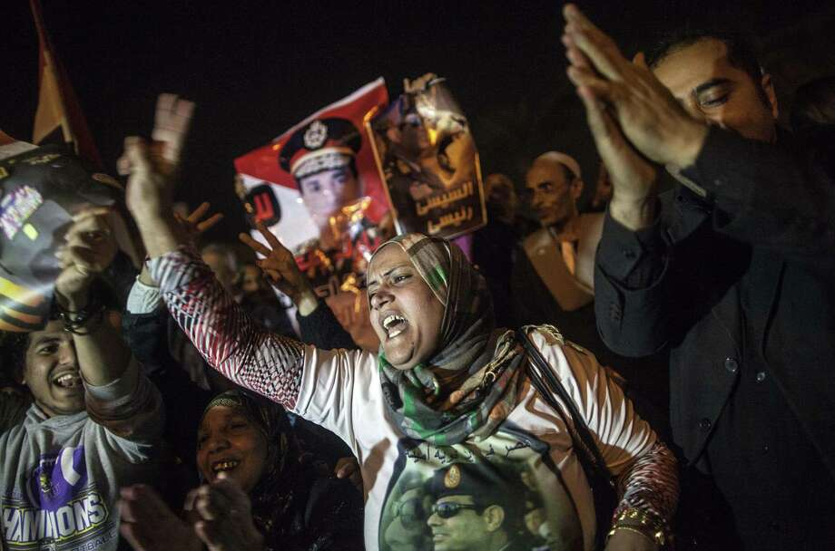 Egyptians celebrate in Tahrir Square in Cairo after the new constitution was validated in what the government said was an endorsement of the overthrow of President Mohammed Morsi. Photo: Mahmoud Khaled / Getty Images / AFP