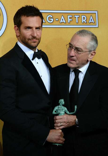 "Actors Bradley Cooper (left) and Robert De Niro, winners of the Outstanding Performance by a Cast in a Motion Picture award for ""American Hustle,"" pose in the press room of the SAG Awards. Photo: Ethan Miller / Getty Images / 2014 Getty Images"