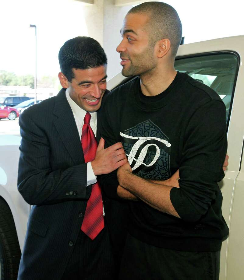 Nicholas LaHood, who is running for district attorney, (left) jokes with Spurs' Tony Parker before his kickoff campaign event Saturday Jan. 18, 2014 at the St. Paul Community Center. Photo: San Antonio Express-News / © 2014 San Antonio Express-News