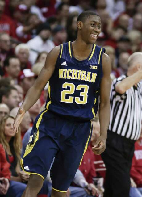 Michigan's Caris LeVert celebrates making a 3-pointer during the Wolverines' upset of No. 3 Wisconsin. LeVert finished with 20 points. Photo: Andy Manis / Associated Press / FR19153 AP