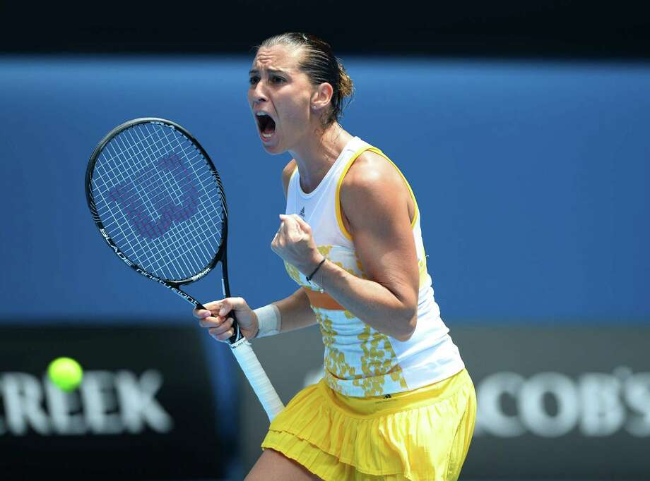 Italy's Flavia Pennetta shouts during her women's singles match against Germany's Angelique Kerber on day seven of the 2014 Australian Open tennis tournament in Melbourne on January 19, 2014.      IMAGE RESTRICTED TO EDITORIAL USE - STRICTLY NO COMMERCIAL USE         AFP PHOTO / WILLIAM WESTWILLIAM WEST/AFP/Getty Images Photo: WILLIAM WEST / AFP