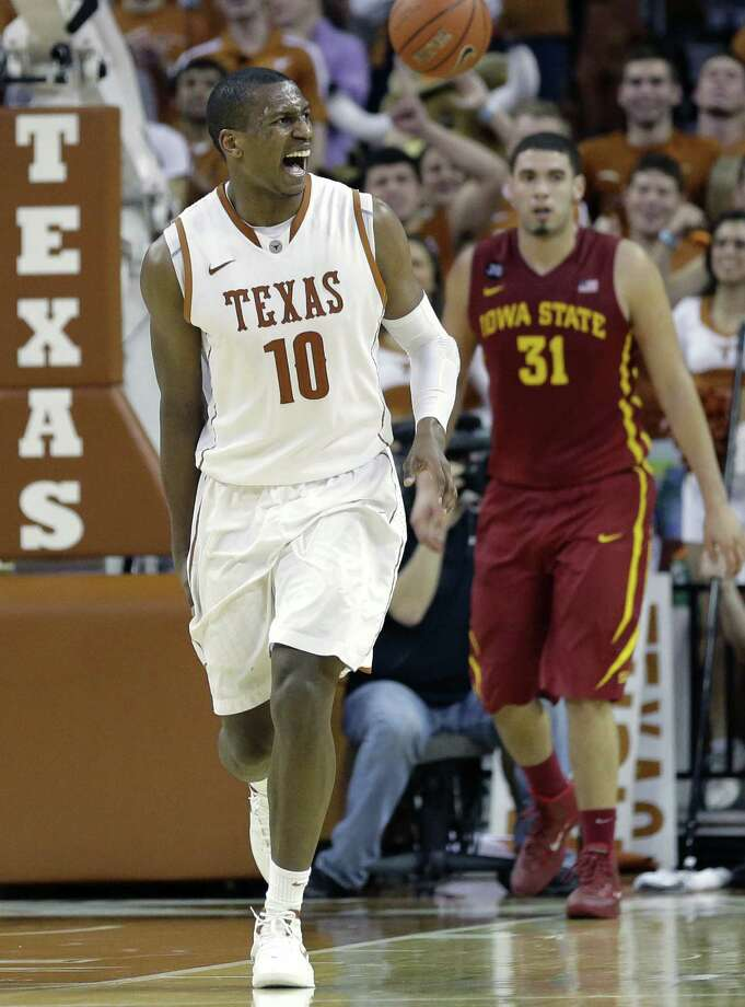 Texas' Jonathan Holmes, who shot 9 for 13 and matched his career high with 23 points, looks to the bench against Iowa State at the Erwin Center. UT improved to 14-4, 3-2 in the Big 12. Photo: Eric Gay / Associated Press / AP