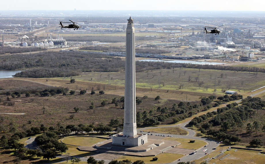 Apache Longbows fly past the San Jacinto Monument near La Porte. The Army wants to take these aircraft from the Guard. Photo: Photos By Edward A. Ornelas / San Antonio Express-News / © 2014 San Antonio Express-News