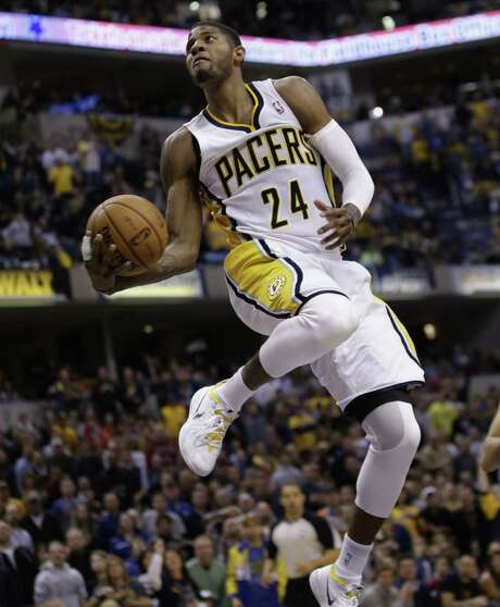 Pacers forward Paul George scores in style with a 360-degree dunk during a blowout of the typically high-flying Clippers on Saturday. Photo: AJ Mast / Associated Press / FR123854 AP