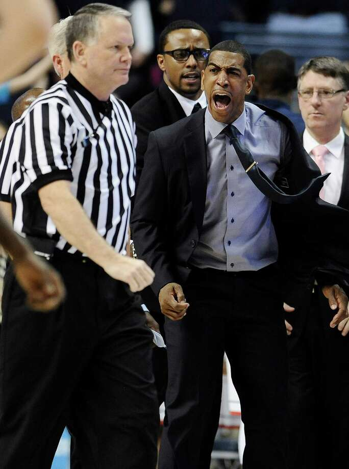 Connecticut head coach Kevin Ollie, right, yells toward an official during the second half of an NCAA college basketball game against Louisville, Saturday, Jan. 18, 2014, in Storrs, Conn. Ollie received two technical's and was ejected from the game. Photo: Jessica Hill, AP / Associated Press