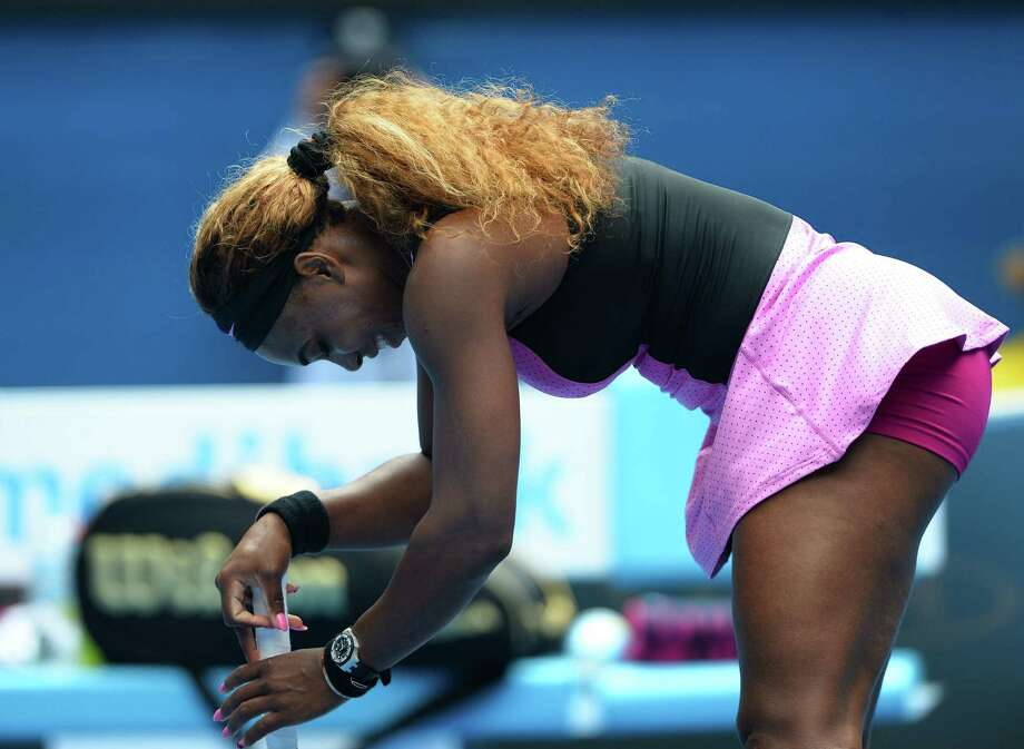 Serena Williams leans on her racquet during Ana Ivanovic's 4-6, 6-3, 6-3 victory in the fourth round at the Australian Open in Melbourne. The loss ended Williams' 25-match winning streak. Photo: William West / Getty Images / WILLIAM WEST