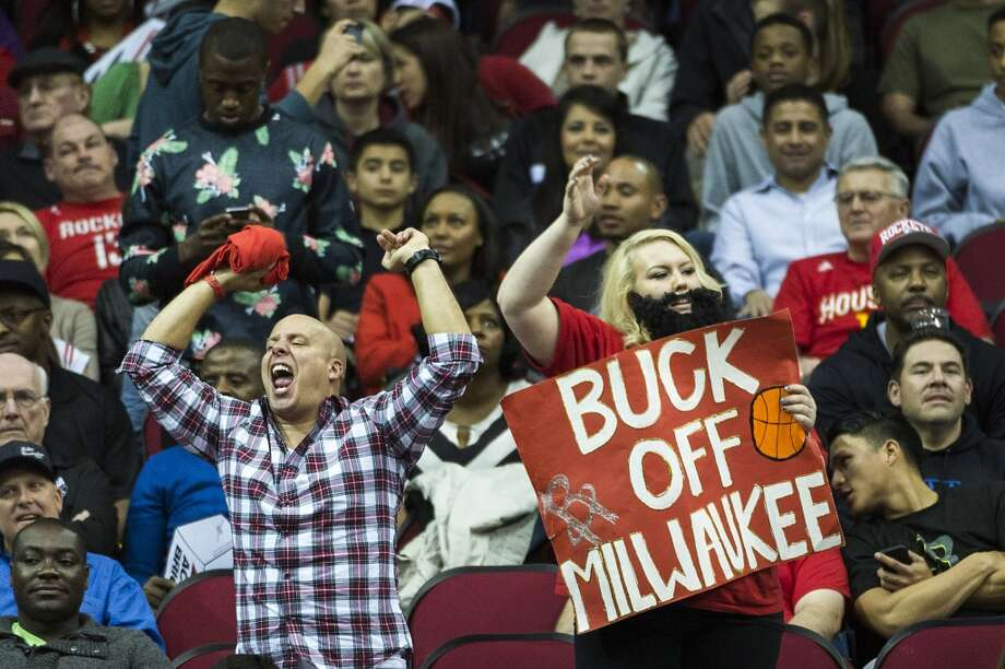 Rockets fans cheer their team during the second half of a 114-104 victory over the Bucks. Photo: Smiley N. Pool, Houston Chronicle