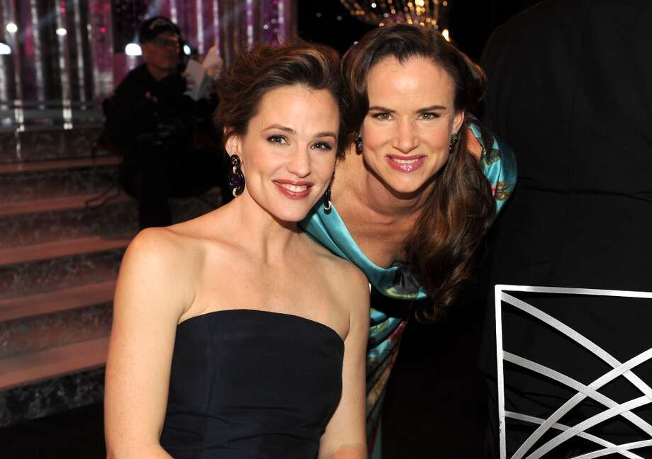 Jennifer Garner, left, and Juliette Lewis pose in the audience at the 20th annual Screen Actors Guild Awards at the Shrine Auditorium in Los Angeles on Saturday, Jan. 18, 2014. Photo: Frank Micelotta, Frank Micelotta/Invision/AP
