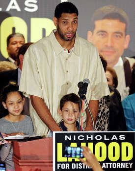 Spurs' Tim Duncan, with his children Sydney (left) and Draven, speaks during Nicholas LaHood's kickoff campaign event for district attorney Saturday Jan. 18, 2014 at the St. Paul Community Center. Photo: Edward A. Ornelas, San Antonio Express-News / © 2014 San Antonio Express-News