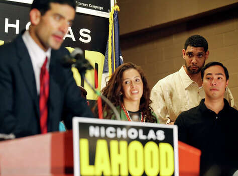 Nicholas LaHood, who is running for district attorney, (from left) speaks as his wife Davida, Spurs' Tim Duncan, and U.S. Rep. Joaquin Castro listen Saturday Jan. 18, 2014 at the St. Paul Community Center. Photo: Edward A. Ornelas, San Antonio Express-News / © 2014 San Antonio Express-News