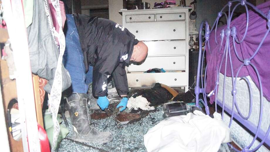 Fire investigators remove samples of carpet at the home of Dr. Genese Bell, Splendora Independent School District superintendent, about 1 a.m. Sunday. Photo: Scott Engle, Montgomery County Police Reporter
