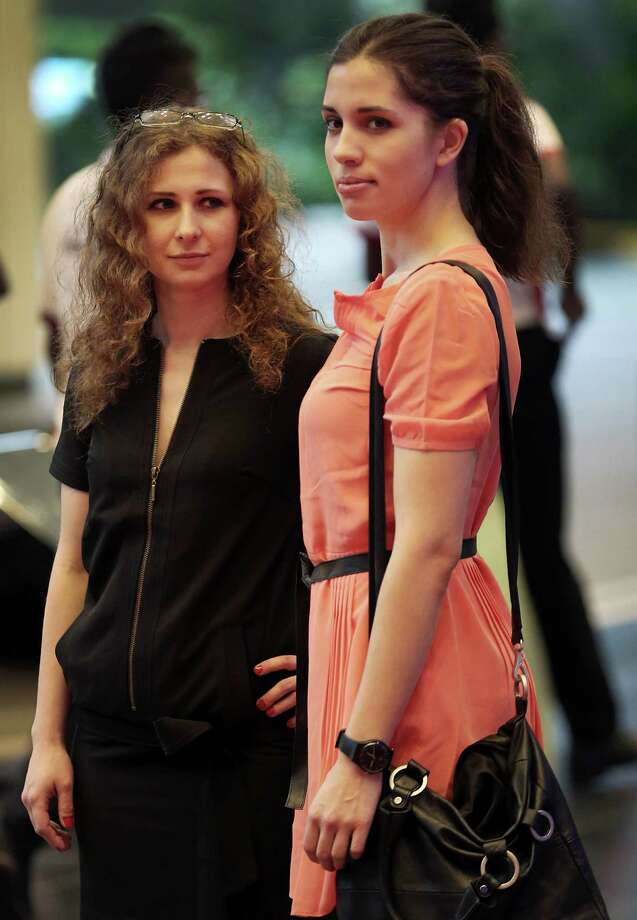 Russian punk band Pussy Riot members Nadezhda Tolokonnikova, right, and Maria Alekhina arrive on Saturday, Jan. 18, 2014 for the Prudential Eye Awards in Singapore. They were in the city-state to attend the inaugural Prudential Eye 