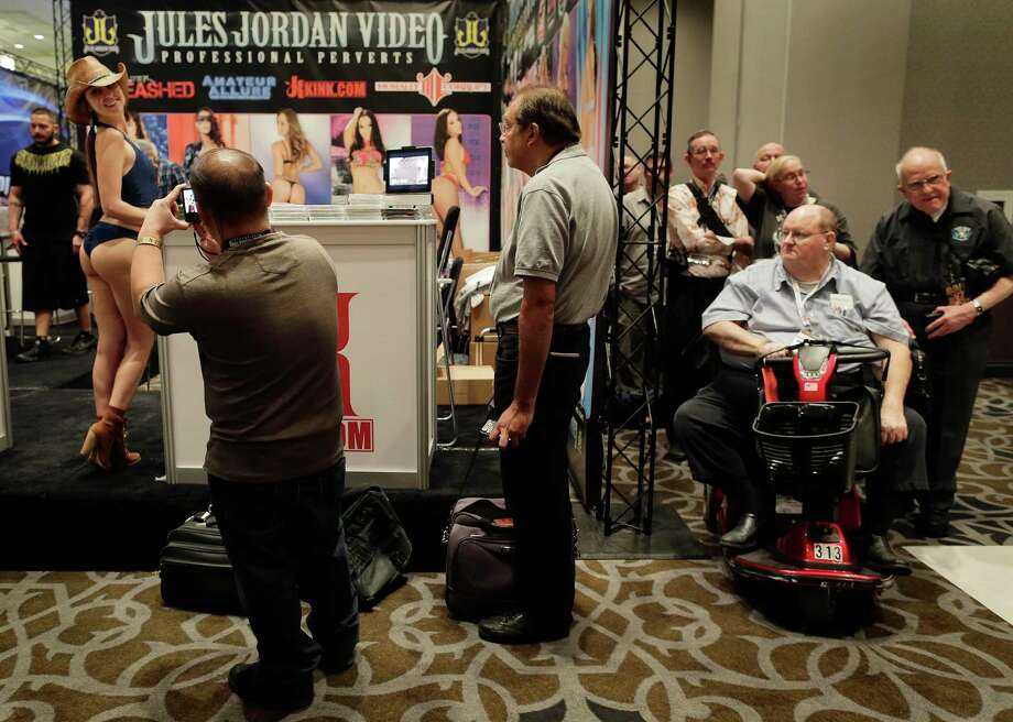Porn industry affiliates and fans wait in line for an autograph from porn star Riley Reid at the Adult Entertainment Expo, Wednesday, Jan. 15, 2014, in Las Vegas. Potential opportunities for X-rated film production in Nevada were the talk of the Expo at the Hard Rock hotel and casino this week, sparked by a Los Angeles law requiring male actors to wear condoms. Photo: Julie Jacobson, AP  / AP