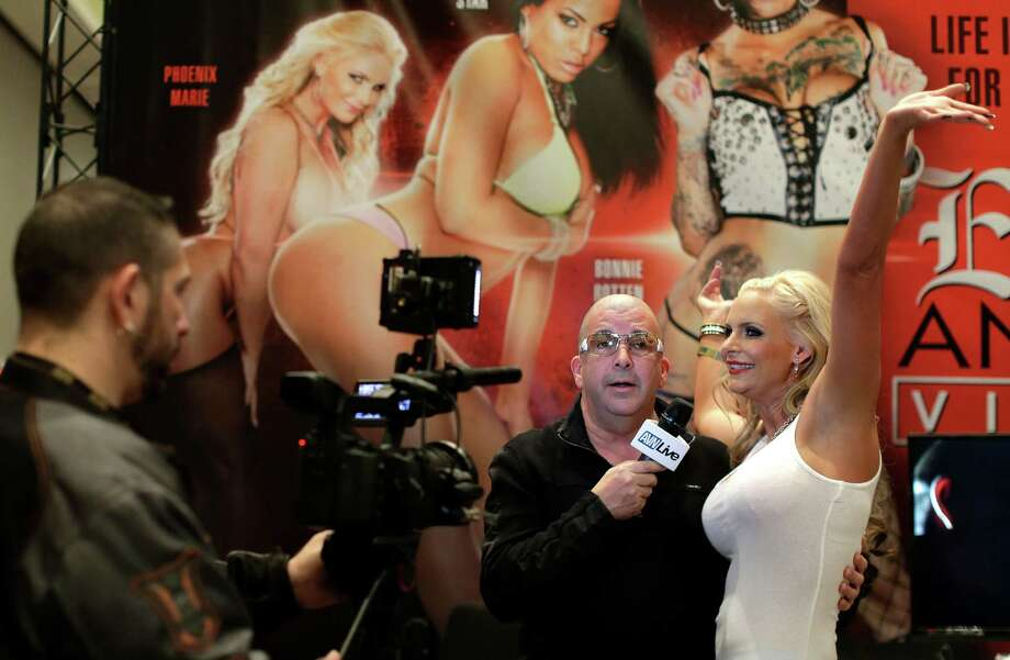 Porn star Phoenix Marie does an interview with the Adult Video Network during the Adult Entertainment Expo, Wednesday, Jan. 15, 2014, in Las Vegas. Potential opportunities for X-rated film production in Nevada were the talk of the Expo at the Hard Rock hotel and casino this week, sparked by a Los Angeles law requiring male actors to wear condoms. Photo: Julie Jacobson, AP  / AP