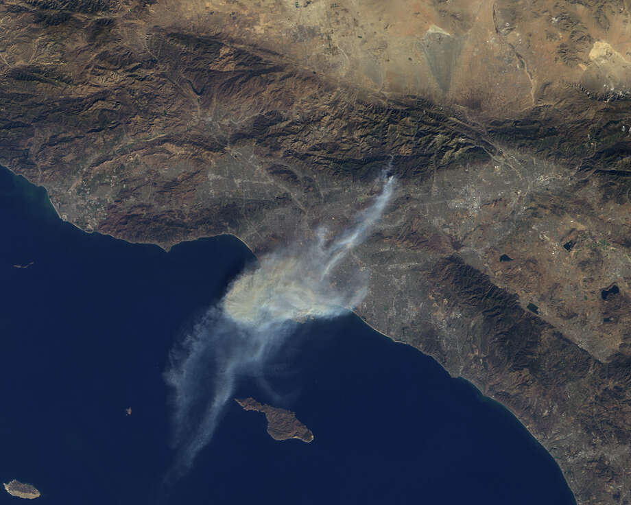 This image provided by NASA shows a satellite photo of smoke from the Colby Fire taken by the Multi-angle Imaging SpectroRadiometer (MISR) instrument aboard NASA's Terra spacecraft as if passed over Southern California, on Jan. 16, 2014. The fire burned more than 1,863 acres and forced the evacuation of some  3,700 people. Photo: AP  / NASA