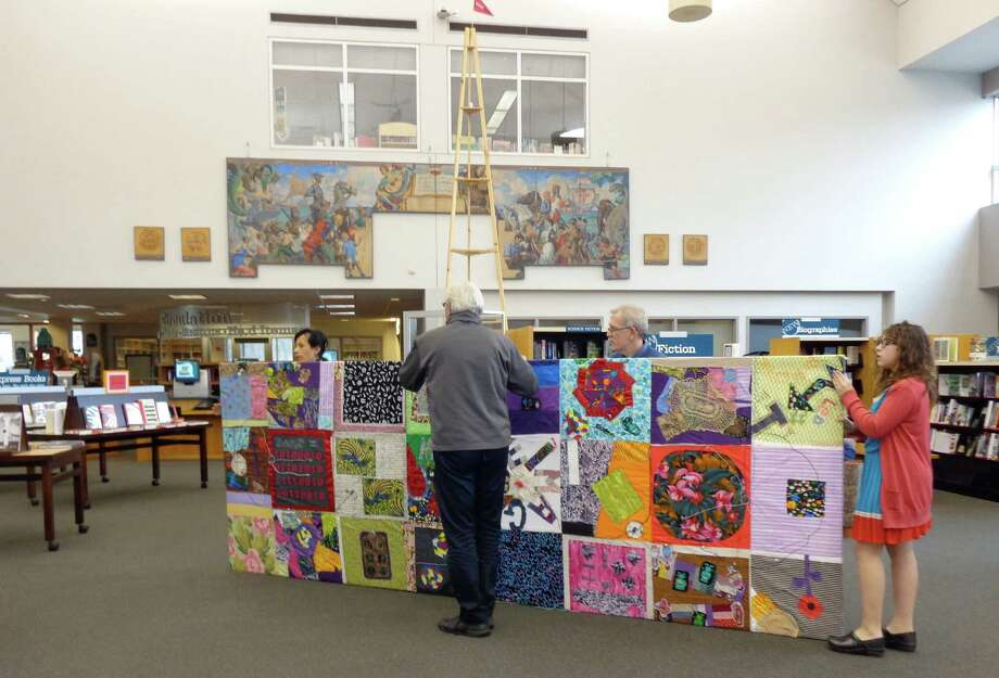 The digital quilt created over the last few months at the Westport Library's MakerSpace is readied for installation Saturday at the library's Great Hall. Photo: Meg Barone / Westport News contributed