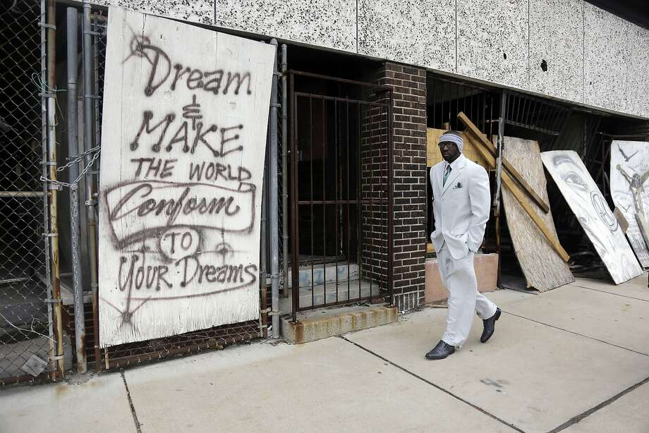 Melvin White, founder of the Beloved Streets of America project, walks down Dr. Martin Luther King Jr. Drive in St. Louis, one of more than 900 U.S. streets named after the civil rights leader. Photo: Jeff Roberson, Associated Press