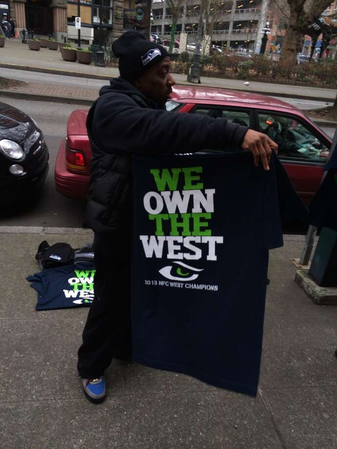 Seahawks hawker says they own the West. (Al Saracevic/Chronicle)