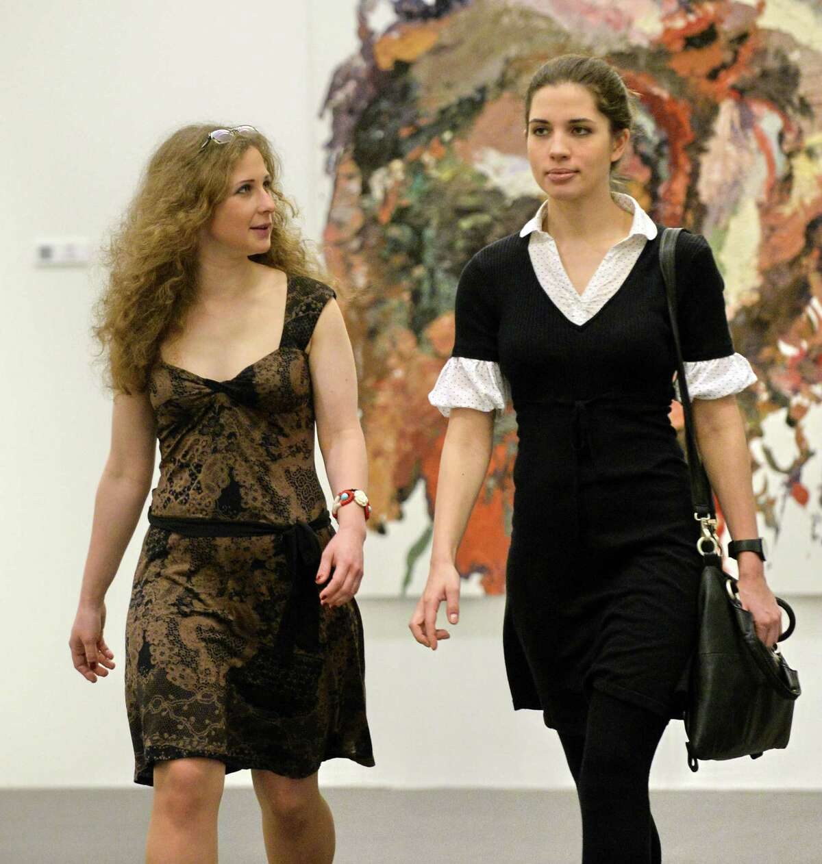 Members of the Russian punk rock band Pussy Riot Nadezhda Tolokonnikova (R) and Maria Alyokhina (L) arrive at a preview of the nominees for the inaugural Prudential Eye Awards in Singapore on January 17, 2014. The two members of Russian punk band Pussy Riot made their first international appearance since their release from prison last month, ahead of the awards ceremony for emerging Asian artists for which their anti-Putin video is shortlisted. The video didn't win.